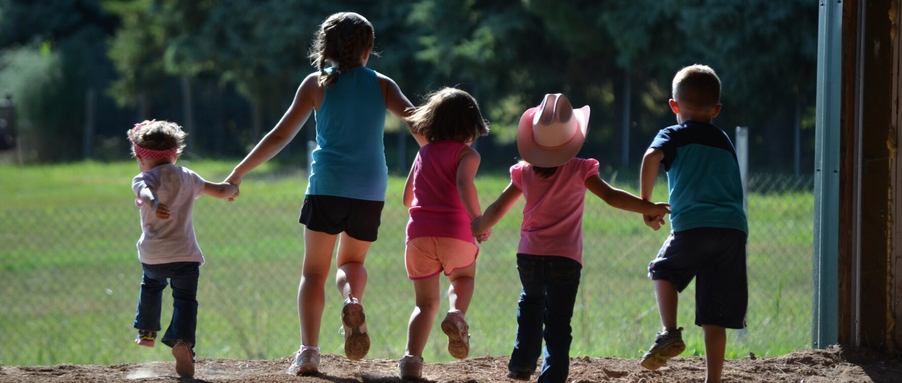 Kids walking out of the barn